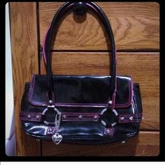 Hosts Pick! Black & hot pink purse / handbag Price reflects the 25% off sale . Super cute black & hot pink small purse XOXO Bags