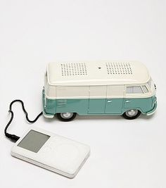 Made me smile: Classic Volkswagen bus-style speaker with a port and cable for playing your iPod. Functional wheels; flashing head and taillights and horn sound option; volume control; radio pre-set...