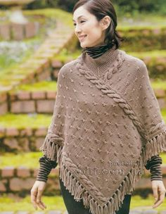 Women's poncho with fringe - knitting. Very nice