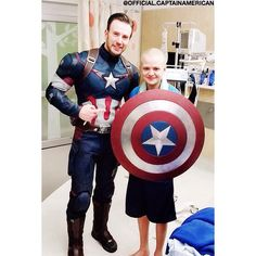 Chris is not only cute, handsome, hot but a true hero. Dressed up to surprise sick kids, takes picture and let's them hold his shield what a guy.