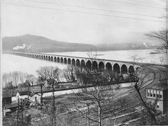 Rockville Bridge, Pennsylvania c1902 The Rockville Bridge after completion in 1902. Note the 4 tracks across the bridge. Note the canal? in the foreground. Appears to be taken from the east side of the river looking NW.