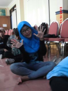 Blue hijab and black glasses