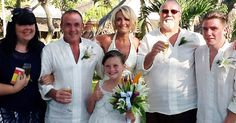 It has taken a year for Gavin Howkins and wife Jo to put up a photo from their dream wedding on a tropical island paradise.