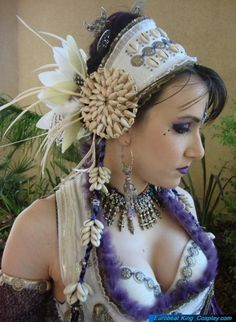 (etsy magpiecanada)  I love everything this lady has in her shop.  I wanted to post this on my Pinterest Board for inspiration. Wonder how difficult it would be to recreate?  I also wonder what she used to anchor the flowers and feathers?