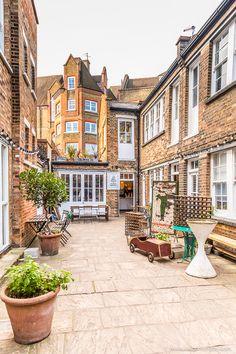 A hidden courtyard tucked away behind the Columbia Road Flower Market in London.   #london #courtyard #market
