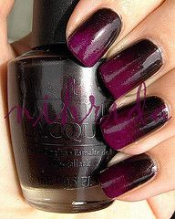 Gradient manicure    Colors: OPI Midnight in Moscow & Color Club Power Play  Made with sponge.