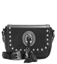 Saint Laurent - Kim embellished leather shoulder bag - Saint Laurent's 'Kim' leather shoulder bag is cool and compact for day-to-dark transitioning. Silver-tone hardware and tonal leather tassels that are adorned with the brand's iconic 'YSL' logo charm add a bohemian feel. Sling yours over one shoulder for an instant dose of chic. seen @ www.mytheresa.com