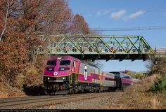 An MBTA train accelerates away from the Westborough station on its way to Worcester.