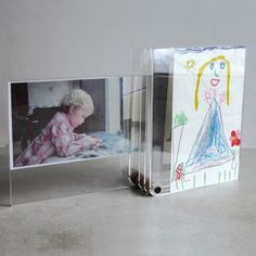 Awesome little picture showcase.  L'ATELIER d'exercises Photo Display.  $85 via Dwell store.