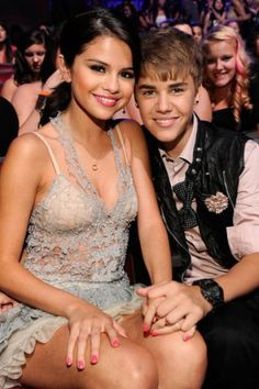Selena Gomez's dress features all-over lace and halter neckline. Buy your own today!