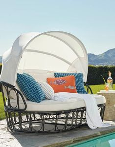 Perfectly sized for two, our Santos Daybed's sun-blocking Sunbrella® privacy canopy keeps you cool while you lounge, converse or catch a quick nap. All-weather resin wicker is hand woven around the powdercoated aluminum frame. Double-wrapped foam core cushion is upholstered in 100% solution dyed and woven fabric.