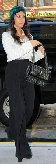Who made Kourtney Kardashian's black pants, black pumps, white shirt and purse that she wore in New York? Pants – Catherine Malandrino  Shirt – Alice + Olivia  Shoes – Alexander McQueen  Purse – Christian Louboutin