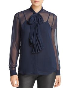 Make a statement in this sheer front tie blouse.