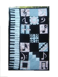hmmm still looking for ideas for my moms piano quilt, not loving this but i do like the keyboard on the side