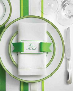 A length of grosgrain drawn through a notched card recalls prep school spiffy ribbon belts with monogrammed buckles.