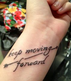 "My newest tattoo!!!! I LOVE IT!!!! It helps to remind me no matter what or where I'm at in life or what I'm dealing with to stay positive and don't give up! To keep going, to ""keep moving forward""!!!"