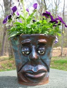 Face plant pot made from stoneware. Will not crack in winter.