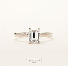Our 'Contour' engagement ring set with an Emerald-cut diamond:    http://www.77diamonds.com/classic_rings.html