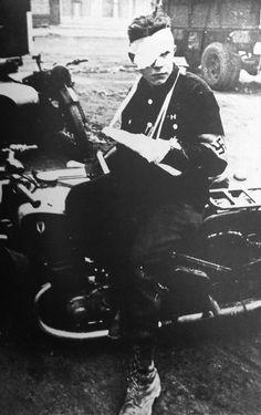 A Wounded HitlerJugend messenger on the Western Front, 1944.