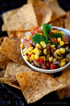 Roasted Corn Salsa made with corn, red bell pepper, tomatoes, green chilies, red onion, jalapeno, lime juice, garlic, cilantro, ground cumin, salt, & pepper.  Yum Yum