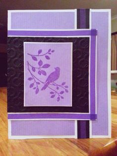 J: Lilac & black embossed card with bird stamped image and purple washi tape.