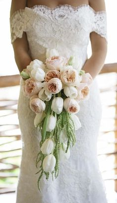 Chic blush peonies and white tulip wedding bouquet; Featured Photographer: Stephen Karlisch, Via Inside Weddings