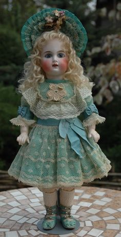"""A gorgeous dress and a hat made of cotton, turquoise. Made of cotton lace and silk ribbons. The dress is fastened with three buttons. The hat is lined in cotton. Suitable for doll size 12""""-13"""". Antique stile! 