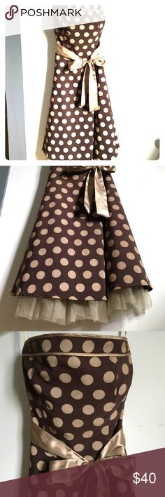 50's strapless polka dot dress Brown dress with gold polka dots and gold sash. Very cute! Stretchy material. size 3 but fits up to size 7/8 worn only 2 times to a 50s car show. Great condition. Dresses Strapless