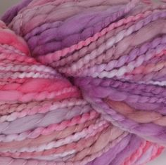 Lecco in Pinks and Purples. Lecco is our new 100% Cotton yarn.  Each ball weighs 100g (3.5 oz) and has approximately 100m (110 yds).  We recommend a needle size of 6-8 mm/ 10–11 US to get 3.5 stitches per in.    Lecco is a super soft thick and thin 100% cotton yarn that provides lots of texture for that special project in mind.  Available in solid and gorgeous variegated color palettes. Perfect yarn for newborn and beyond. Visit our website to find a retailer near you.