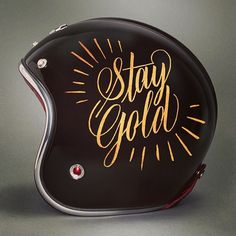 Simple striping around some hand lettering on a helmet …