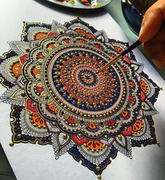 United Kingdom based artist Asmahan A. Mosleh creates beautiful mandalas. The peaces, often gilded with gold leaf, begin with a pencil outline which she then traces in pen, and finally paint. Pearl…