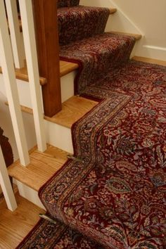 Zoroufy's Decorative stair holds in Antique Brass on a carpet runner from the Diamont series in Keshan Red and Navy from the Dynamic Rug Co.