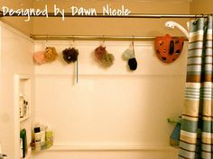 Add a 2nd curtain rod in the back to hang shower poufs, kids toys, etc. Would be great for wet swimsuits too! kids shower curtain, hang shower curtain, organizing kids swimsuits, organizing kids bathroom, curtain rods, organization tips kids, curtains for shower curtain, kids toy organization, kids toys organize