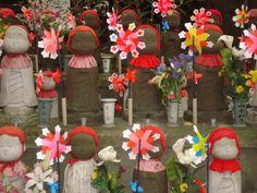 Jizo statues at Zojoji Temple, Tokyo, Japan. 2006