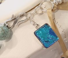 Aurora necklaces of natural stones have signature fused glass charm