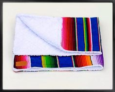 A gorgeous dream of a blanket. Soft serape and luxurious sherpa materials. Locally designed and produced. Colors may vary.