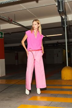 nude, silk top , leather belts, fluo washed pants