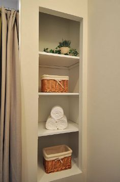 Built-in shelving next to the shower adds storage and character in this small bathroom Upstairs Bathrooms, Downstairs Bathroom, Storage In Small Bathroom, Bath Shelf, Built In Shelves, Home Reno, Cozy House, Bathroom Ideas, Shelving