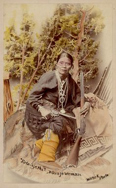 Hand-Colored Photoprint of Esta-Yeshi, Navajo Woman, in Native Dress with Guns - Wittick - 1893 #native american #hand colored #woman #navajo #1890s #1893