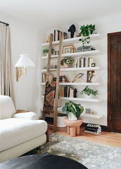 What's the key to a beautiful shelfie? A natural finishing touch with an added pop of freshness. Include a couple faux plants for a maintenance-free look. Shop this look by @raising3foodies at Afloral.com. Decorating Small Spaces, Decorating Your Home, Bauhaus, Keep Life Simple, Library Wall, Ladder Bookcase, White Shop, White Walls, Ladder Decor