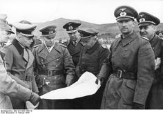 Field Marshal Erwin Rommel during inspection trip to the French-Spanish border in February 1944. Reading the map with Rommel are General Hans von Obstfelder (to the right of Rommel) and Vice Admiral Friedrich Ruge (behind Rommel). The trip was part of Rommel's preparations for an Allied invasion of France.