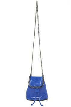 "Stylish compact size cross body bag made of distressed glossy leather in fashion color cobalt featuring a gun metal color ruthenium diamond cut chain trim and matching metal shoulder strap. Flap over front with magnetic closure underneath flap in addition to drawstring top. Fully lined interior in color tan fabric.  Measures 9""W (top) 5""W (when drawstring gather at top) X 9""W (bottom) X 7""H X 3 1/2""""D. Shoulder strap 21 1/2"" drop.  Cobalt Crossbody by Leather Country. Bags - Cross Body…"