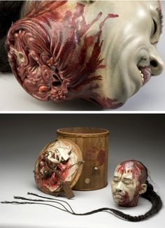 """reginasworld:    """"This model head is reportedly an executed Chinese Yangstze river pirate. It is made of plaster. The long ponytail is real human hair. It is particularly gruesome because it depicts the head in great anatomical detail. Arteries, veins and spinal cord are accurately modelled across the severed neck. The head also has its own bloodstained carrying box. The origins and purpose of the model are uncertain."""""""