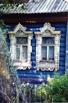 .Awesome old windows on a blue log cabin...