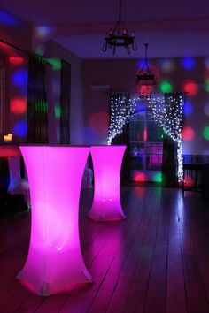 Illuminated poseur tables, cool white pealight curtain and wall uplighters in purple in the Maiden's Tower at Leeds Castle by www.stressfreehire.com #venuetransformers - this would be a great look for the side barn at Farbridge
