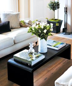 Coffee table details with white flowers