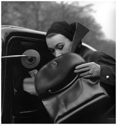 Sophie Litvak. Cape and bag by Jacques Fath. Photo: Georges Dambier, 1953.
