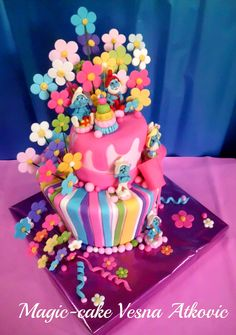The Smurfs...colorful topsy turvy cake