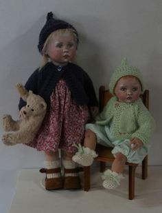 Two small jointed cloth dolls made by Susie McMahon