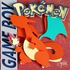 "Pokemon Red Charizard Layered Paper Art Piece 8""x8"" Shadowbox Frame These Paper CutOuts are designed using Scale Vector Graphics and cut using a paper cutter for precision details. Than by hand they are arranged"